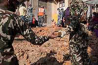 Rescue workers remove the rubble from a collapse site in Pathan, Kathmandu, Nepal.