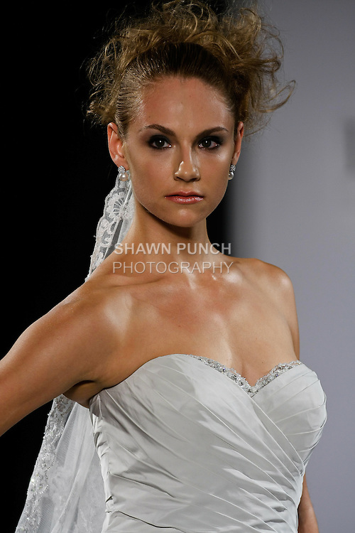 Model walks runway in a Montrose wedding dress from the Ian Stuart - Supernova Bridal Collection 2013 fashion show, at the Couture Show during New York Bridal Fashion Week, October 14, 2012.