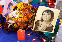NWA Democrat-Gazette/DAVID GOTTSCHALK  Photographs, skulls and objects make up the the Altar of Death put on display Monday, November 2, 2015, recognizing Dia de Los Muertos, Day of the Dead, in the Student Union on the campus in Fayetteville. The display and other activities were sponsored by the University Hispanic Heritage Month committee and recognized the Central and South American holiday.