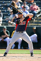 Travis Hafner of the Cleveland Indians bats against the Oakland Athletics in a spring training game at Phoenix Municipal Stadium on March 2, 2011  in Phoenix, Arizona. .Photo by:  Bill Mitchell/Four Seam Images.