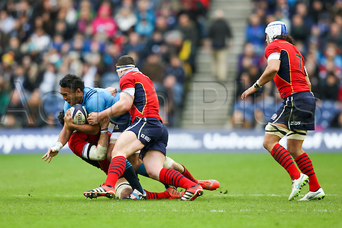 28.02.2015.  Edinburgh, Scotland. 6 Nations International rugby Championship. Scotland versus Italy.  Scotland stop a charge by Italy's Kelly Haimona.