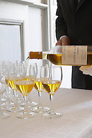 Aperitif served in the entrance hall, a glass golden yellow of Chateau de Cerons poured in a glass by a magnificent butler waiter Chateau de Cerons (Cérons) Sauternes Gironde Aquitaine France