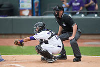 Winston-Salem Dash catcher Omar Narvaez (22) sets a target as home plate umpire Skylar Shown looks on during the Carolina League game against the Myrtle Beach Pelicans at BB&T Ballpark on April 18, 2015 in Winston-Salem, North Carolina.  The Pelicans defeated the Dash 4-1 in game one of a double-header.  (Brian Westerholt/Four Seam Images)