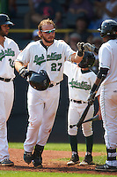 Clinton LumberKings catcher Adam Martin (27) fist bumps teammates after hitting a home run during a game against the Great Lakes Loons on August 16, 2015 at Ashford University Field in Clinton, Iowa.  Great Lakes defeated Clinton 3-2.  (Mike Janes/Four Seam Images)