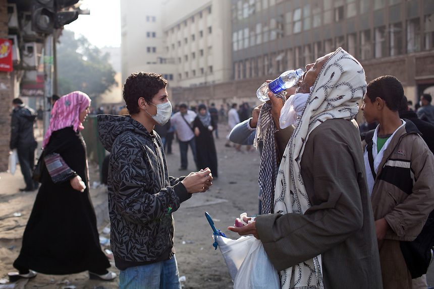 Egyptian protesters share water during clahses at Cairo's Tahrir Square, November 20, 2011. Photo: Ed Giles.