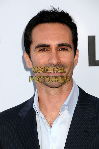 "NESTOR CARBONELL.""Lost"" Live: The Final Celebration held at UCLA's Royce Hall, Westwood, California, USA..May 13th, 2010.headshot portrait blue black pinstripe .CAP/ADM/BP.©Byron Purvis/AdMedia/Capital Pictures."
