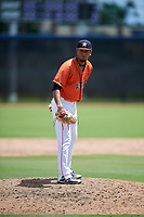 GCL Astros relief pitcher Jervic Chavez (19) looks in for the sign during a game against the GCL Marlins on August 5, 2018 at FITTEAM Ballpark of the Palm Beaches in West Palm Beach, Florida.  GCL Astros defeated GCL Marlins 2-1.  (Mike Janes/Four Seam Images)