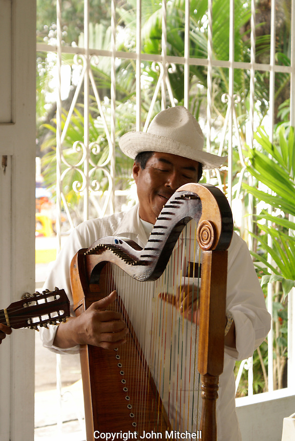 Traditional son jarocho harpist performing in a restaurant in Catemaco, Veracruz, Mexico