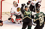 Dallas' Brenden Morrow, center,  celebrates with teammate Jussi Jokinen after scoring on Chicago's Nikolai Khabibulin in the third period during an NHL hockey game at the American Airlines Center in Dallas on Sunday, April 8, 2007.  Dallas won 3-2.  (Star-Telegram/Khampha Bouaphanh)