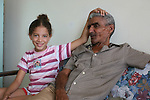 ©2008 David Burnett / Contact Press Images..July 13 2008..Havana, Cuba.Nate Thornburgh (TIME) and Demaris  (ex wife of former band member Piri) who lives in Mexico: with her daughter Sabina .. and the father of Piri, her former partner, who comes to visit on a Sunday.©2008 David Burnett / Contact Press Images..July 13 2008..Havana, Cuba.Nate Thornburgh (TIME) and Damaris  Veloz (ex wife of former band member Piri) who lives in Mexico: with her daughter Sabina .. and the father of Piri, her former partner, who comes to visit on a Sunday.