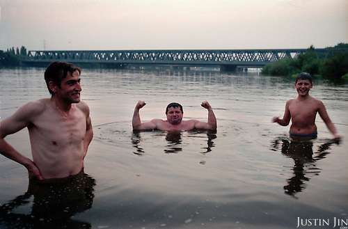 Bulgarian immigrants swim in the Elbe River, separating Hamburg from the island suburb Wilhemsburg. ..Wilhemsburg is one of the most ethnically diverse quarters in Hamburg, with Africans, former Yugloslavians and Turks as the largest groups. ..