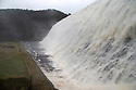 23/02/17<br /> <br /> Peter Fletcher stops to take photographs as high winds and heavy rain send a vast torrent of water rushing over the Derwent Dam wall and into the air as Storm Doris batters the Derbyshire Peak District between Sheffield and Glossop.<br /> All Rights Reserved F Stop Press Ltd. (0)1773 550665 www.fstoppress.com