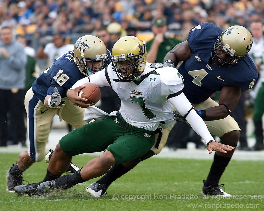 Pittsburgh defensive back Elijah Fields (4) tackles South Florida quarterback BJ Daniels. The Pittsburgh Panthers defeated the South Florida Bulls 41-14 at Heinz Field, Pittsburgh, PA on October 24, 2009.