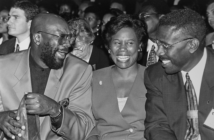 Rep. Sheila Jackson Lee, D-Tex., sits between Musician/Composer Isaac Hayes and National Bar Association President U. Lawrence Boze at the Congressional Black Caucus Foundation Reception for CBC President William Porter Payne on Sep. 12, 1996. (Photo by Maureen Keating/CQ Roll Call via Getty Images)