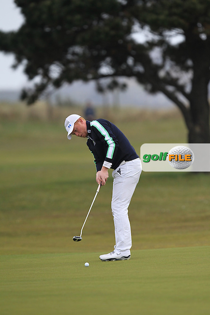 Eanna Griffin (Waterford) on the 18th green during Round 2 of the Flogas Irish Amateur Open Championship at Royal Dublin on Friday 6th May 2016.<br /> Picture:  Thos Caffrey / www.golffile.ie