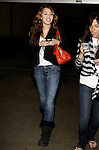 3-17-09.Miley Cyrus leaving the Ikea furniture store in Burbank ca with a bright red purse..AbilityFilms@yahoo.com.805-427-3519.www.AbilityFilms.com.