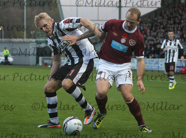 Gary Teale (left) being heavily pressured by Jamie Hamill in the St Mirren v Heart of Midlothian Clydesdale Bank Scottish Premier League match played at New St Mirren Park, Paisley on 5.11.11.