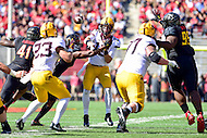College Park, MD - OCT 15, 2016: Minnesota Golden Gophers quarterback Conor Rhoda (15) barely gets rid of the ball to Minnesota Golden Gophers running back Shannon Brooks (23) during game between Maryland and Minnesota at Capital One Field at Maryland Stadium in College Park, MD. (Photo by Phil Peters/Media Images International)