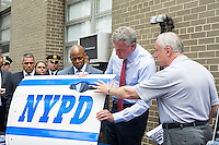 New York Mayor Bill de Blasio, left ,and NYPD Commissioner William Bratton examine a reinforced RMP door while briefing the media about improvements to police equipment on Monday, July 25, 2016 at the 84th Precinct in Brooklyn in New York. (© Frances M. Roberts)