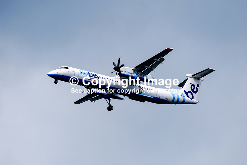 FLYBE aircraft, with undercarriage down, on its approach over Holywood, Co Down, to George Best Airport, Belfast, N Ireland, UK. Reg - G-JEDR. 200908163026.<br />