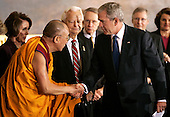 U.S. President George W. Bush (R) and shakes hands with the Dalai Lama after presenting him with the Congressional Gold Medal in Washington DC USA on 17 October 2007. Also on stage are (L to R) Speaker of the U.S. House of Representatives Nancy Pelosi, Democratic Senator Robert Byrd, Democratic Majority Leader Harry Reid, Senator Minority Leader Mitch McConnell