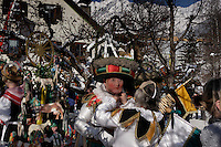 Bright colors highlight the Schleichers wearing masks and hats weighing up to 50 pounds as they parade in Scheischenlaufen.  It is an ancient festival held every five years in the Tyrol (Tirol) region.  The custom is derived from cults and their rituals, going  as far back as the pre-Christian era.   The Telfs carnival has been held every 5 years since 1890.
