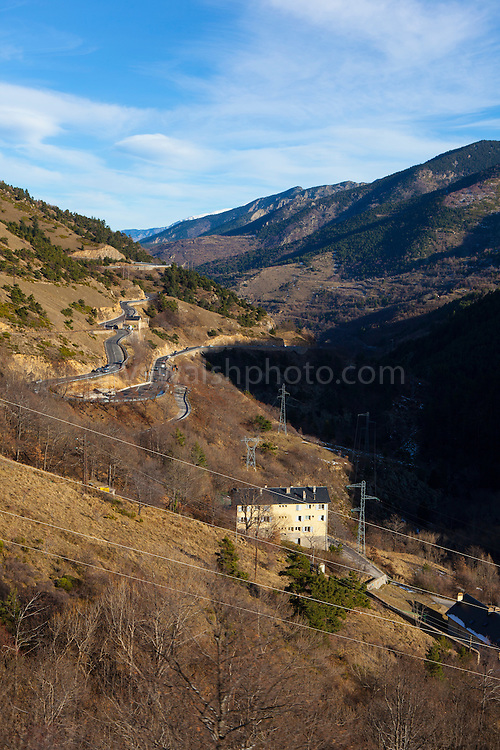 View of Route Nationale 116 road from the Train Jaune, Yellow Train, Canari, or Ligne de Cerdagne, is a 63km long railway from Villefranche-de-Conflent to Latour-de-Carol, rising from 427m to 1,593m at Bolquère-Eyne, the highest railway station in France. In early 2015 the future of the line was uncertain, with SNCF and the French government considering either to close the line, or to privatise it for tourism use.