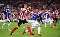 Lincoln City's Harry Anderson vies for possession with Exeter City's Lloyd James<br /> <br /> Photographer Andrew Vaughan/CameraSport<br /> <br /> The EFL Sky Bet League Two Play Off First Leg - Lincoln City v Exeter City - Saturday 12th May 2018 - Sincil Bank - Lincoln<br /> <br /> World Copyright &copy; 2018 CameraSport. All rights reserved. 43 Linden Ave. Countesthorpe. Leicester. England. LE8 5PG - Tel: +44 (0) 116 277 4147 - admin@camerasport.com - www.camerasport.com