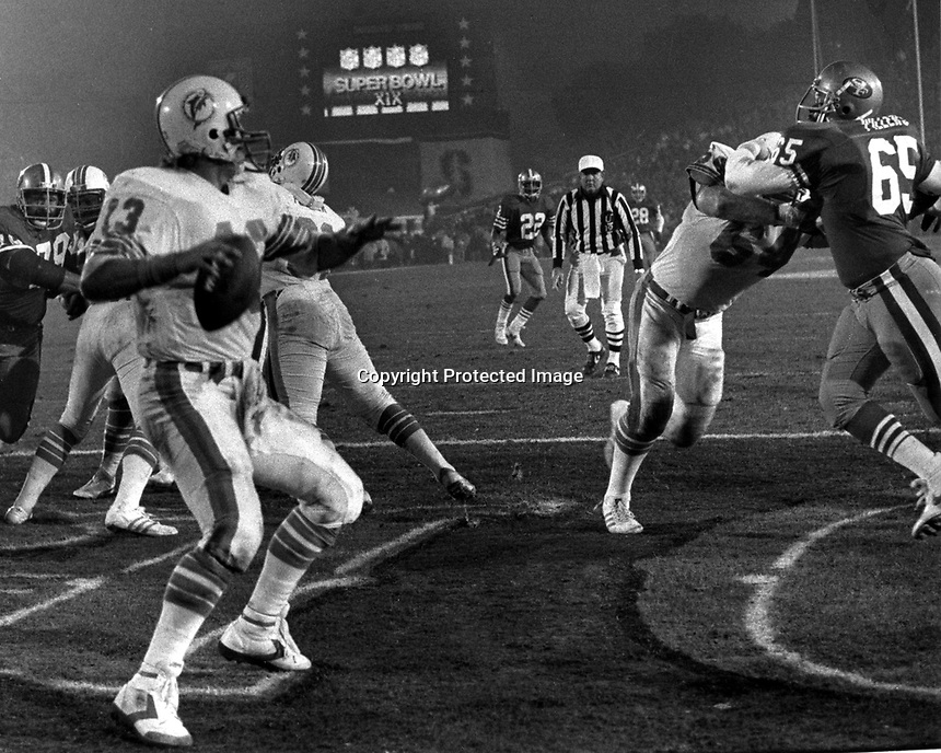 Superbowl X1X at Stanford Stadium Dan Marino ready to throw out of his own end zone against the San Francisco 49ers. Game won by the 49ers. (photo by Ron Riesterer)