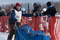 Musher # 64 Timothy Hunt at the Restart of the 2009 Iditarod in Willow Alaska