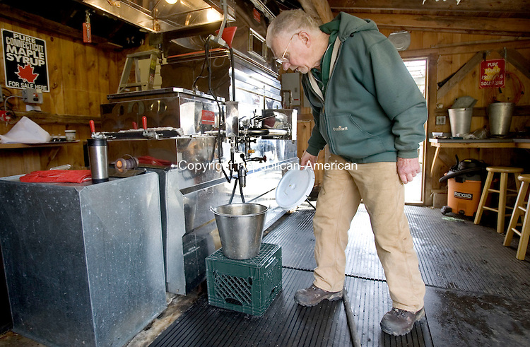 LITCHFIELD, CT. 01 April 2013-040113S10-Mark Harran, president of the Maple Syrup Producers Association of Connecticut, watches over his syrup production in Litchfield Monday..Steven Valenti Republican-American