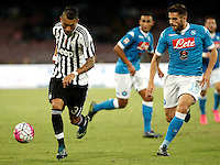 Calcio, Serie A: Napoli vs Juventus. Napoli, stadio San Paolo, 26 settembre 2015. <br /> Juventus&rsquo; Roberto Pereyra, left, is challenged by Napoli&rsquo;s David Lopez Silva during the Italian Serie A football match between Napoli and Juventus at Naple's San Paolo stadium, 26 September 2015.<br /> UPDATE IMAGES PRESS/Isabella Bonotto