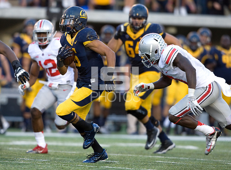 Chris Harper of California runs the ball during the game against Ohio State at Memorial Stadium in Berkeley, California on September 14th, 2013.  Ohio State defeated California, 52-34.