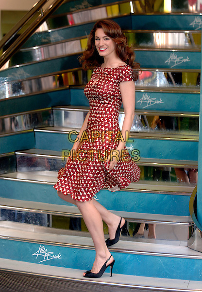 KELLY BROOK.Swimwear press launch & photocall at New Look, 500 Oxford Street, London, UK..April 3rd, 2006.Ref: PL.full length red burgundy pattern hearts dress sling back shoes.www.capitalpictures.com.sales@capitalpictures.com.©Capital Pictures