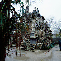 "Ferdinand Cheval (1836 – 19 August 1924) was a French postman who spent thirty-three years of his life building Le Palais idéal (the ""Ideal Palace"") in Hauterives. The Palace is regarded as an extraordinary example of naïve art architecture and is a mix of different styles with inspirations from Christianity to Hinduism. Cheval bound the stones together with lime, mortar and cement."