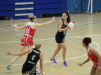 20.1.2014 New Zealand's Joline Henry competes for ball with England's Joanne Harten during their netball test match in London, England. Mandatory Photo Credit (Pic: David Klein). ©Michael Bradley Photography.