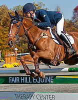 Madeline, with rider Holly Payne (USA), competes during the Stadium Jumping test during the Fair Hill International at Fair Hill Natural Resources Area in Fair Hill, Maryland on October 21, 2012.