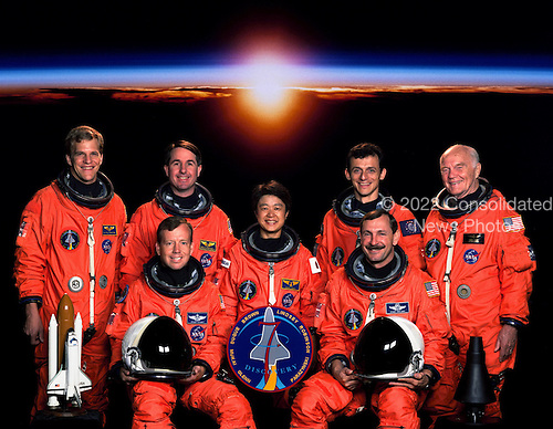 Five astronauts based at NASA's Johnson Space Center (JSC) and two payload specialists scheduled to fly on STS95 take a break from their training regimen to pose for the preflight portrait in Houston, Texas in June, 1998. Seated are astronauts Curtis L. Brown Jr. (right), commander; and Steven W. Lindsey, pilot. Standing, from the left, are Scott E. Parazynski and Stephen K. Robinson, both mission specialists; Chiaki Mukai, payload specialist representing Japan's National Space Development Agency (NASDA); Pedro Duque, mission specialist representing the European Space Agency (ESA); and United States Senator John H. Glenn Jr., payload specialist. The seven are scheduled to be launched into Earth orbit aboard the Space Shuttle Discovery in late October..Credit: NASA via CNP