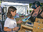 Artist Angie Terrell helps 8-year-old Lucy make a relief print during Artown's Opening Night in Reno on Saturday, July 1, 2017.