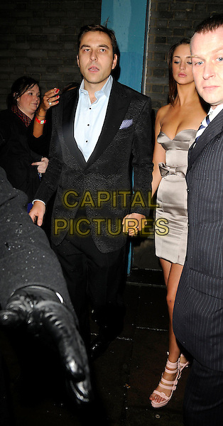 DAVID WALLIAMS & GUEST.Attending the Elle Style Awards 2009 at Big Sky London, England,.February 9th 2009..full length black suit jacket blue shirt holding hands cleavage grey dress strapless bow.CAP/CAN.©Can Nguyen/Capital Pictures