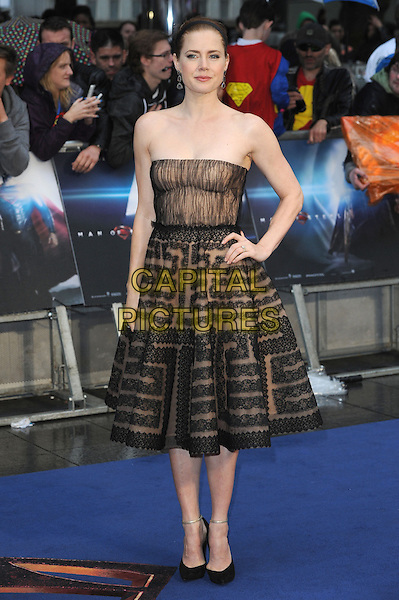 Amy Adams <br /> 'Man Of Steel' UK film premiere, Empire cinema, Leicester Square, London, England.<br /> 12th June 2013<br /> full length beige black strapless dress pattern alice band brown lace hand on hip<br /> CAP/BEL<br /> &copy;Tom Belcher/Capital Pictures