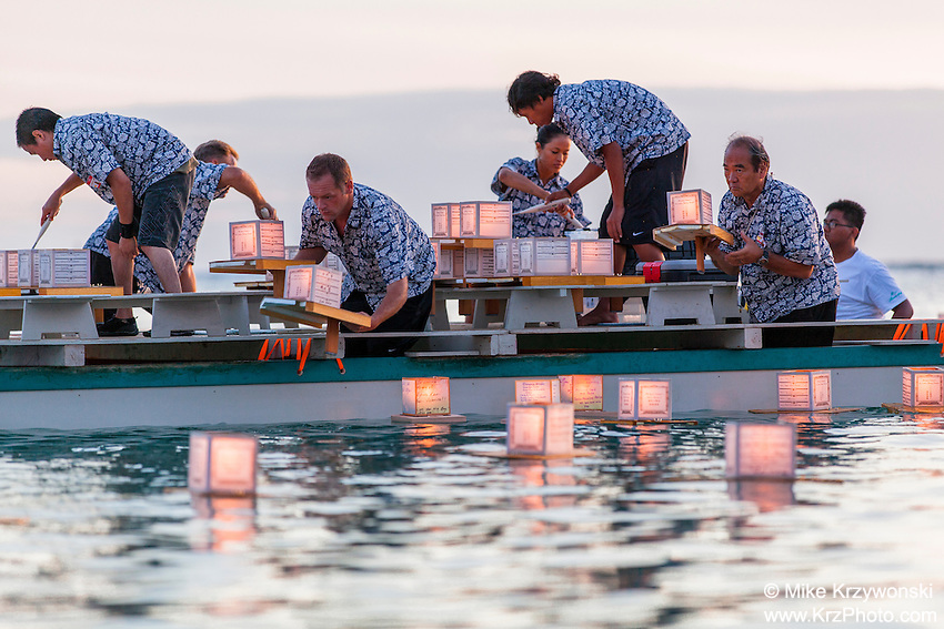 Volunteers on boat placing lanterns in the water at the 15th annual Lantern Floating Ceremony at Ala Moana Beach Park on Memorial Day