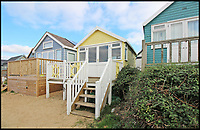 Two Mudeford beach huts - Yours for £500,000.