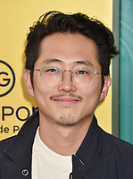 HOLLYWOOD, CA - AUGUST 07:  Steven Yeun arrives at the Warner Bros. Pictures' 'Crazy Rich Asians' premiere at the TCL Chinese Theatre IMAX on August 7, 2018 in Hollywood, California.<br /> CAP/ROT/TM<br /> &copy;TM/ROT/Capital Pictures