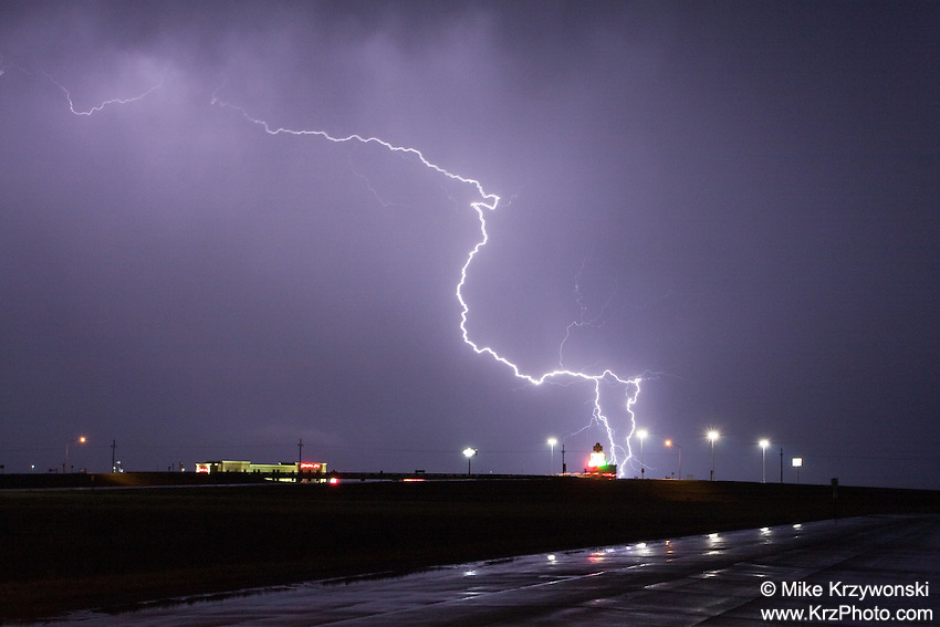 Lightning over a highway at night in Kansas