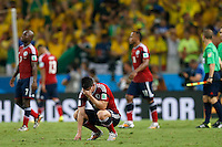 FORTALEZA - BRASIL -04-07-2014. Foto: Roberto Candia / Archivolatino<br /> James Rodriguez (#10) jugador de Colombia (COL) reacciona con desilución después de perder con Brasil (BRA) en partido de los cuartos de final por la Copa Mundial de la FIFA Brasil 2014 jugado en el estadio Castelao de Fortaleza./ James Rodriguez (#10) player of Colombia (COL) reacts with disappointment after losing with Brazil (BRA) in match of the Quarter Finals for the 2014 FIFA World Cup Brazil played at Castelao stadium in Fortaleza. Photo: Roberto Candia / Archivo Latino<br /> VizzorImage PROVIDES THE ACCESS TO THIS PHOTOGRAPH ONLY AS A PRESS AND EDITORIAL SERVICE IN COLOMBIA AND NOT IS THE OWNER OF COPYRIGHT; ANOTHER USE IS REPONSABILITY OF THE END USER. NO SALES, NO MERCHANDASING. ALL COPYRIGHT IS ARCHIVOLATINO