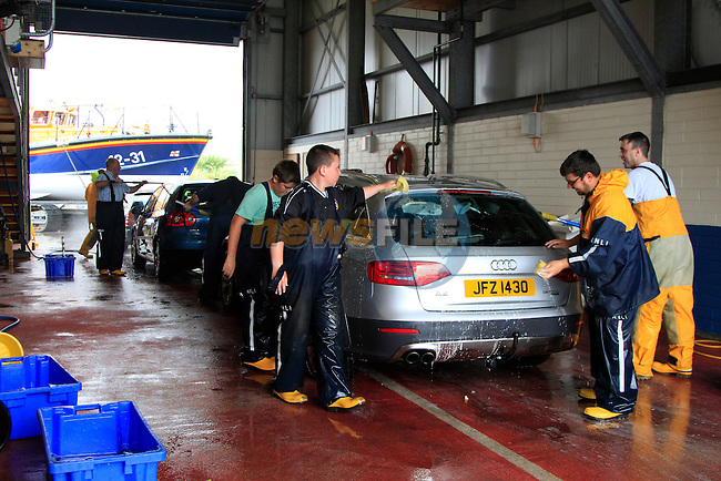 Members of the Clogherhead Lifeboat  during the &quot;Car Wash&quot; in aid of the Clogherhead RNLI Lifeboat on Saturday 12th July 2014.<br /> Picture: Thos Caffrey / Newsfile.ie