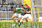 Thou Shalt not pass: Marcus Mangan Milltown/Castlemaine tries to stop Legion star forward James O'Donoghue  during their Club Championship semi final on Sunday