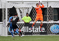 WASHINGTON, D.C. - AUGUST 19, 2012:  Nick DeLeon (18) of DC United watches Zac MacMath (18) of the Philadelphia Union catch the ball during an MLS match at RFK Stadium, in Washington DC, on August 19. The game ended in a 1-1 tie.