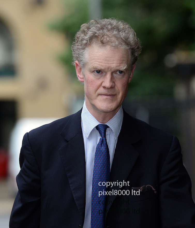 Pics shows: Patrick Gibbs QC barrister for Simon Harwood...PC Simon Harwood arrives at Southwark Crown Court today .the jury was due to deliver a verdict in his trial for the manslaughter of Big Issue seller Ian Tomlinson..He arrived with his wife Helen.....Pic by Gavin Rodgers/Pixel 8000 Ltd 18.7.12
